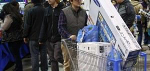A shopper pushes a cart full of electronics at the Best Buy electronics store in Westbury, New York